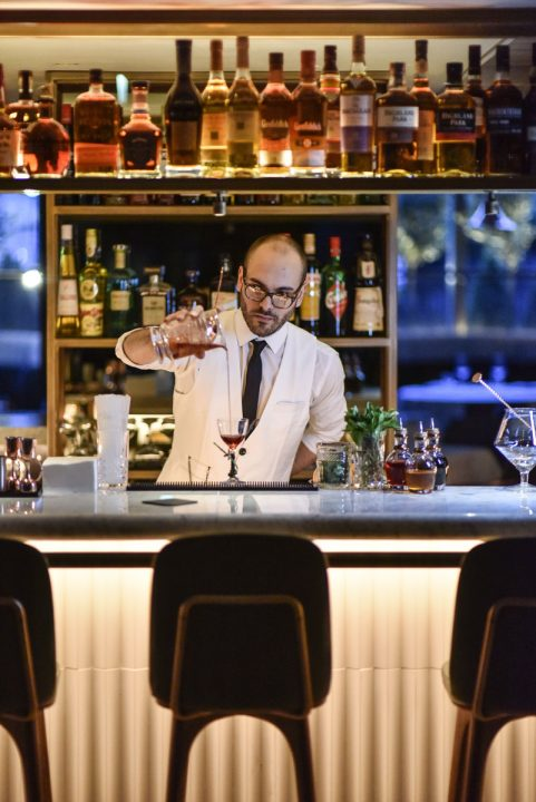 bar tender pouring drinks at il pampero bar