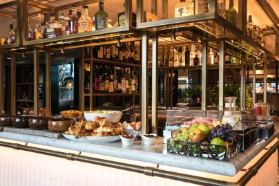 A selection of fresh fruit, croissants, dairy, cheese and ham served on the central bar of il Pampero at breakfast