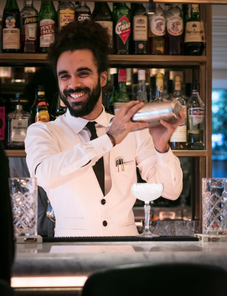 Bar tender happily shaking a cocktail at il Pampero bar
