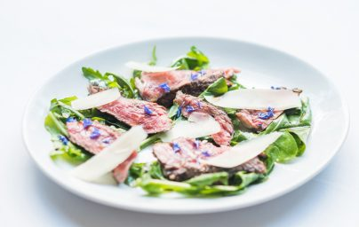 Beef carpaccio served with rocket salad and truffled castelmagno cheese